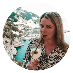 Blonde girl sipping a drink in Italy